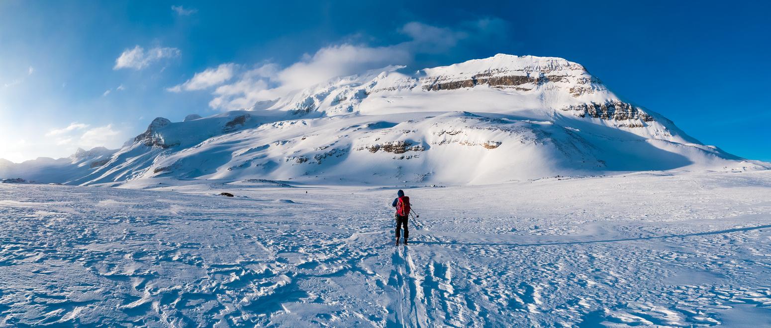 TJ skis towards Mount Balfour in great early morning lighting.