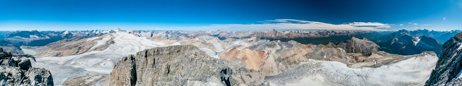 An impressive summit panorama looking over the Wapta Icefield at left, Skoki at center and Lake Louise at right.