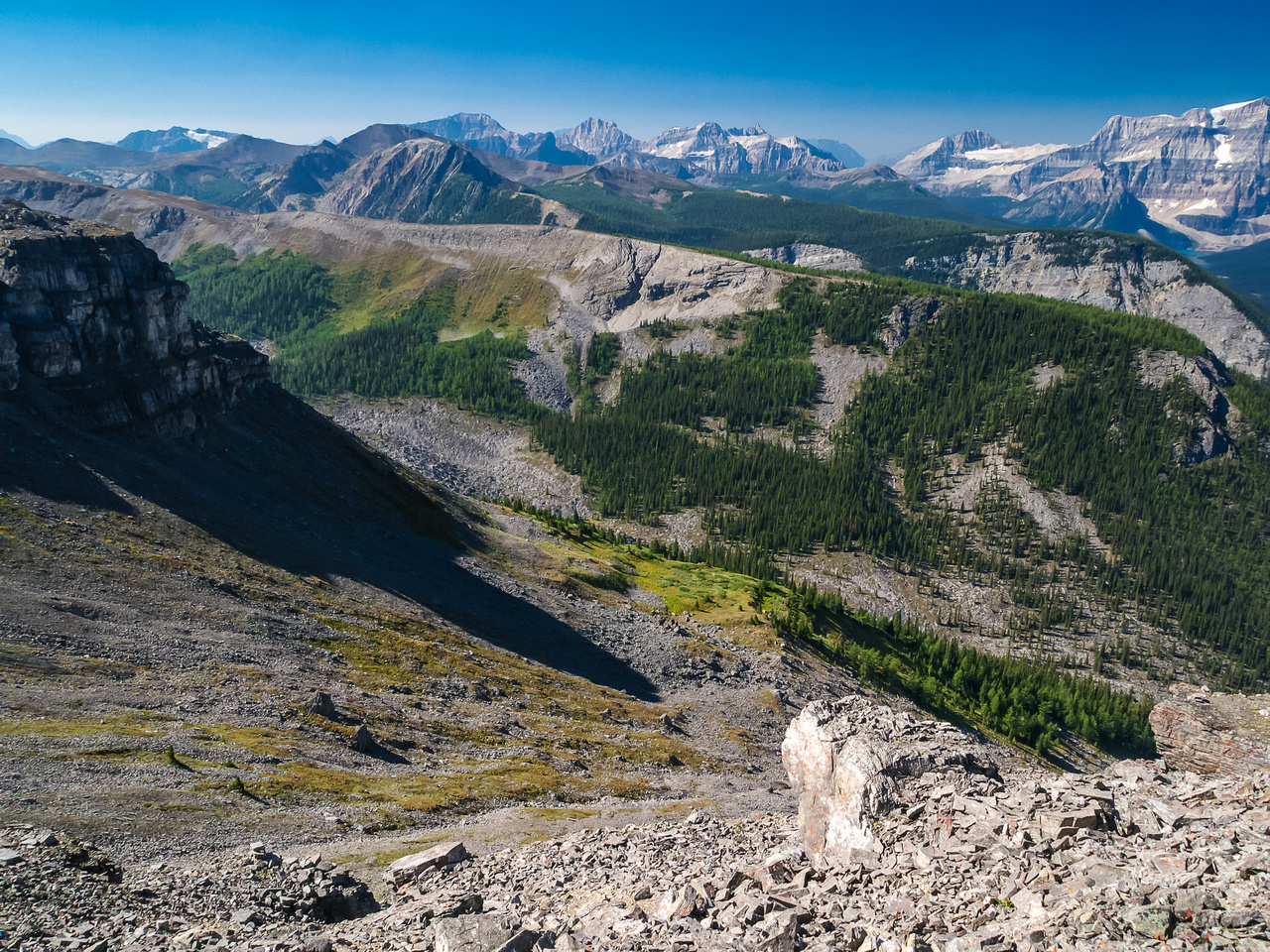Looking down my escape route off the west face with lovely alpine meadows of Lost Horse and Pharaoh Creeks in the distance.