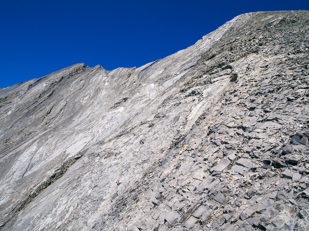 Looking up from the col, false summit at right, summit at left.