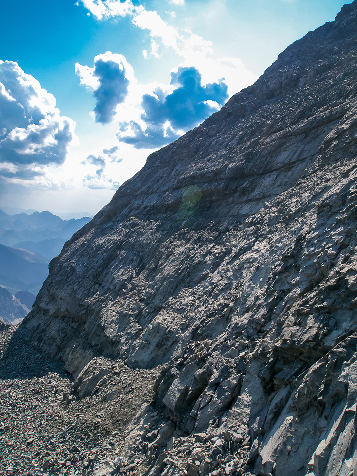 Looking along the steep east wall that leads to the summit - this is where route finding is important.
