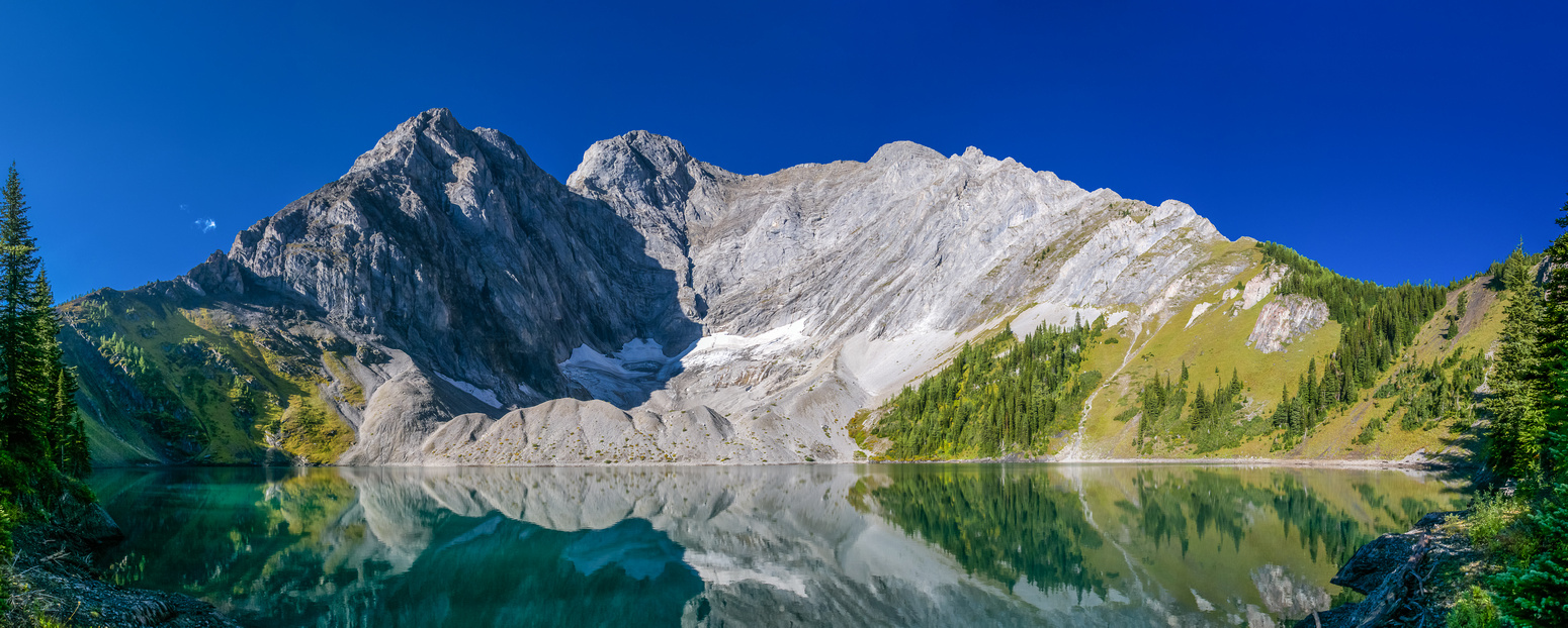 Mount Fox looms over Frozen Lake. The ascent ridge runs from the right side up to the left.