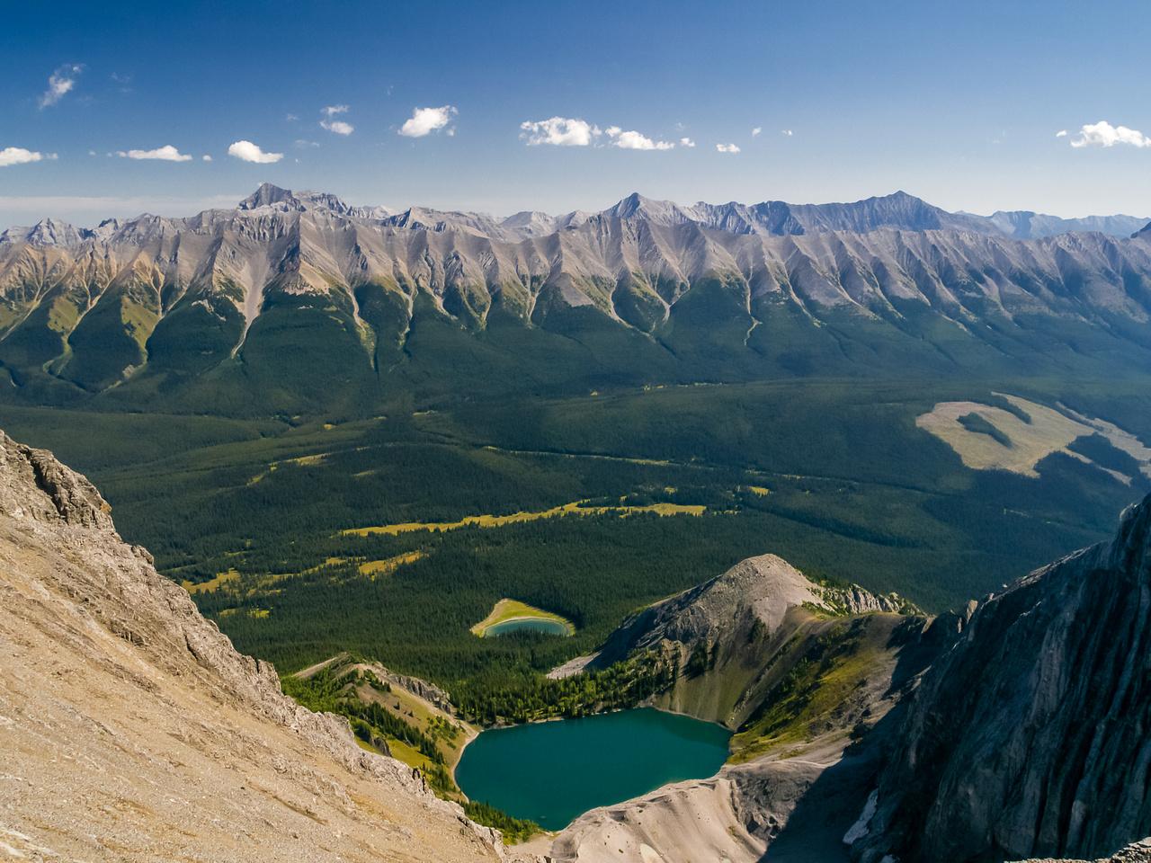 Rae, Storm, Mist, Tyrwhitt & Storelk rise over Fox and Frozen Lakes.