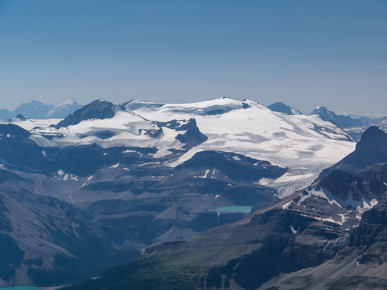 Views over Iceberg Lake towards Mount Gordon and Olive (L).
