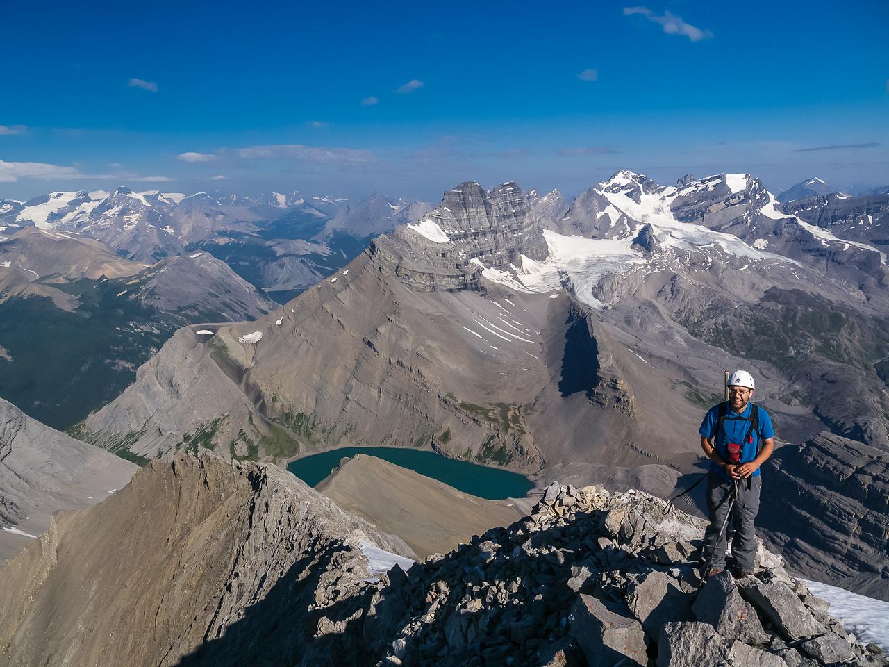 Eric on the summit ridge with Coleman Lake far beneath.