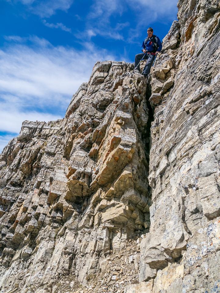 Keith prepares to downclimb.