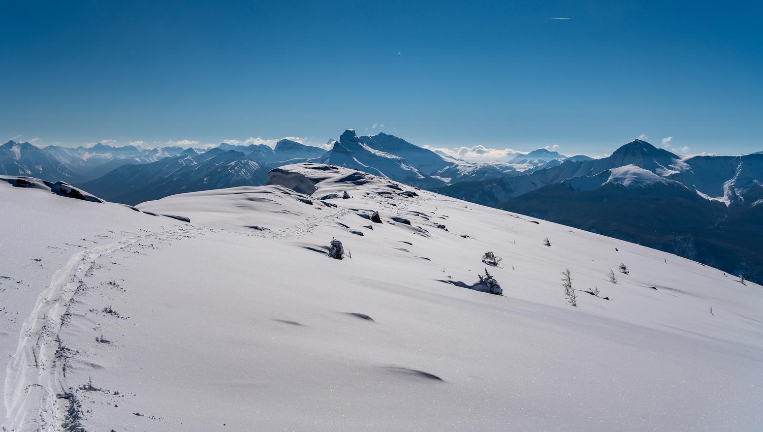 Skiing back along the summit ridge.