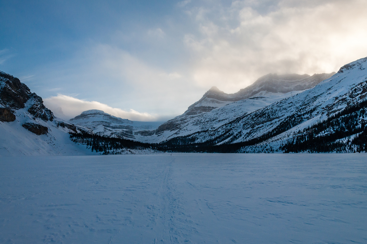 Looking back at Portal and Thompson in fading light as we cross the Bow Lake at dusk.
