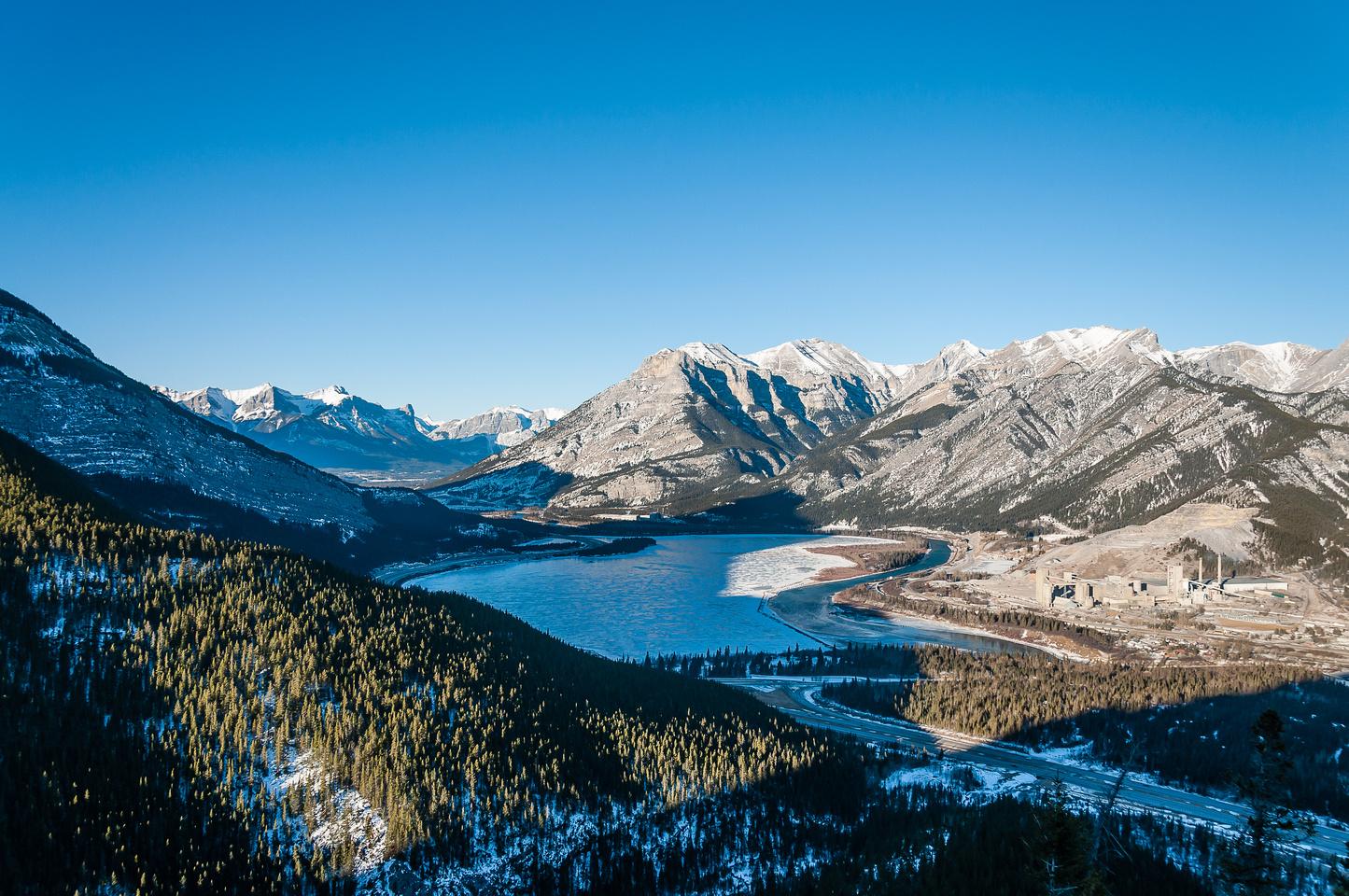Views over Lac des Arcs towards Grotto and Gap Peak (R).