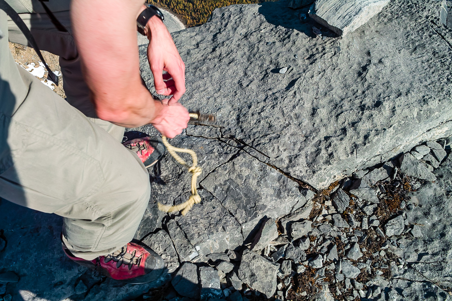 JW just pulled out a rappel / belay pin with fresh cord attached to it. It wasn't very hard to pull out.