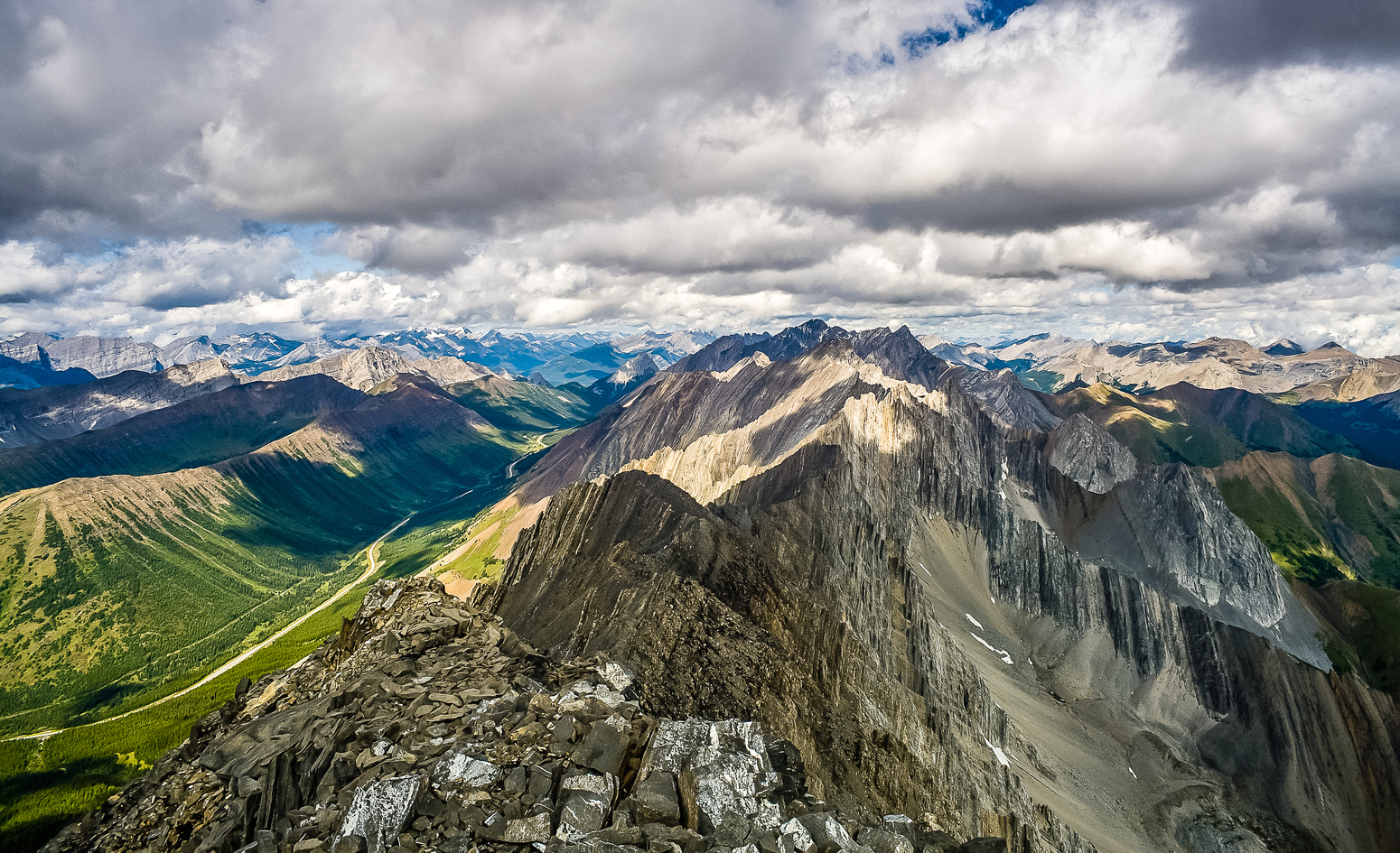 Summit views north include Tyrwhitt, Pocaterra, Highwood Ridge, Pocaterra Ridge, Rae, Storm, Arethusa and Cougar Mountain (L to R).