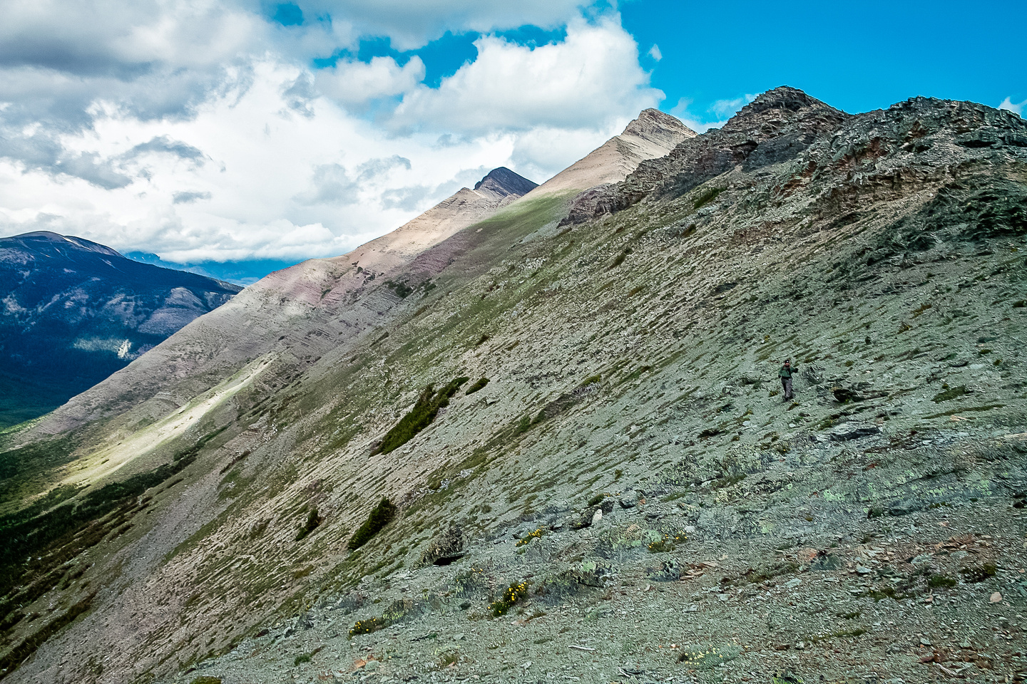 Kev traverses to the St. Eloi col with the south and west summits of Syncline in the bg.