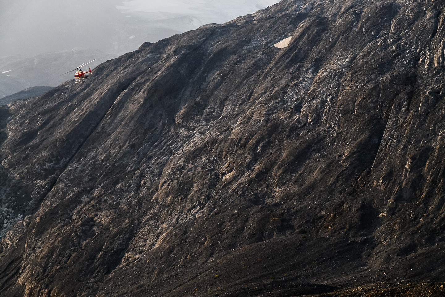 The chopper flies past Warrior's north face.