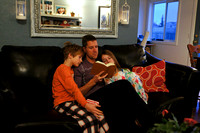 Dad reads the Christmas story.
