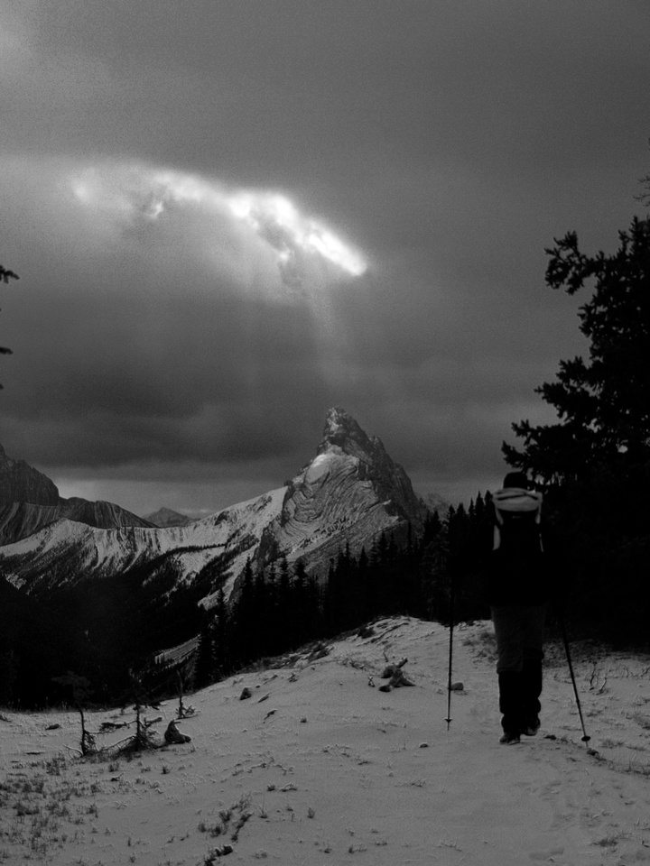 A shaft of light gets the summit of Mount Wintour.