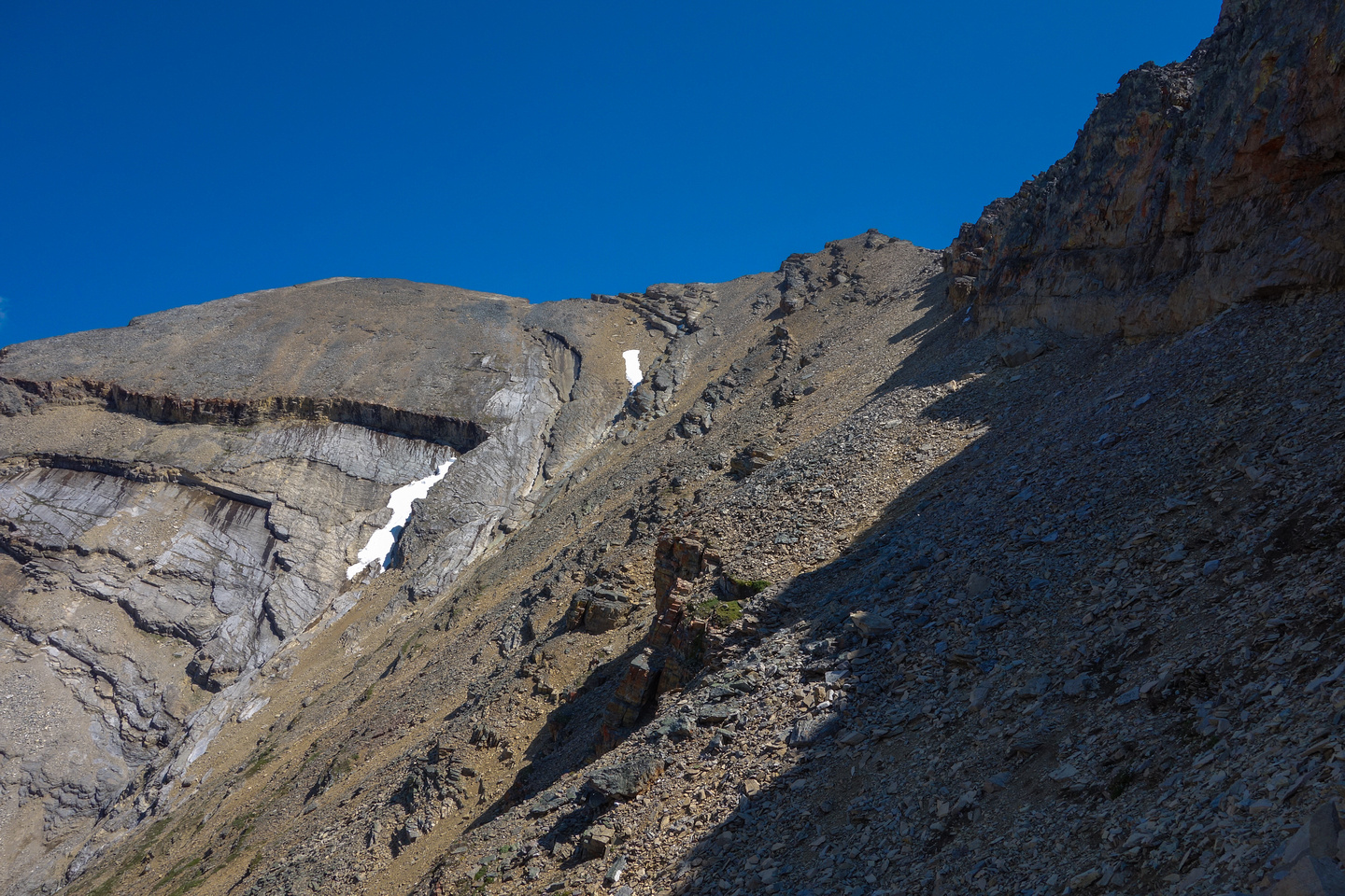 Looking back at a particularly large and long scree ledge I followed from just before getting down to the col on descent.