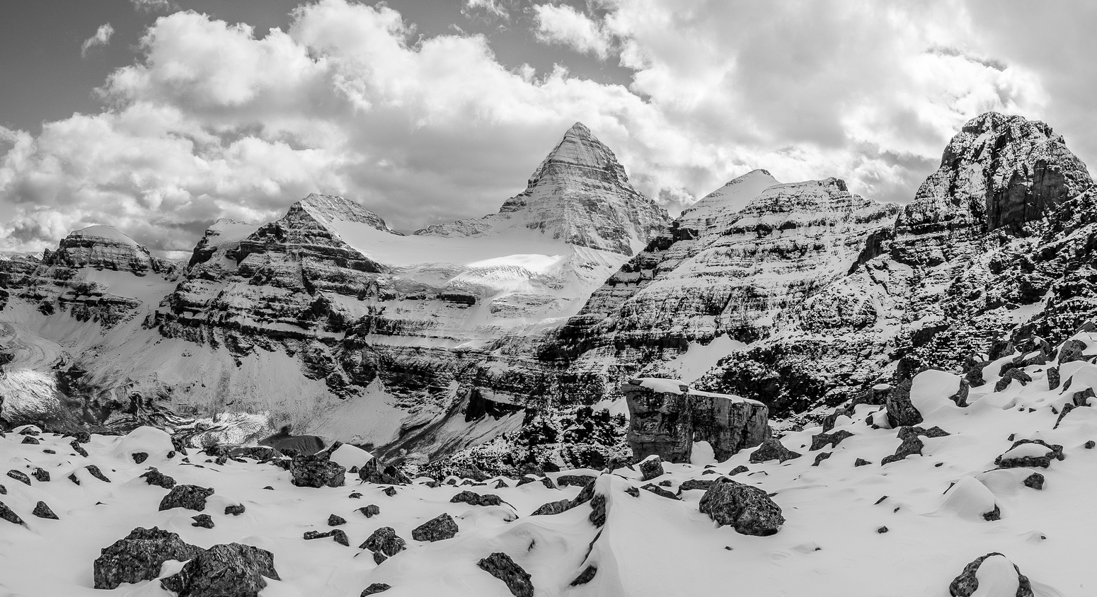 Looking towards Mount Assiniboine with Mount Magog to the left of it and Wedgwood and Sunburst Peaks to the right.