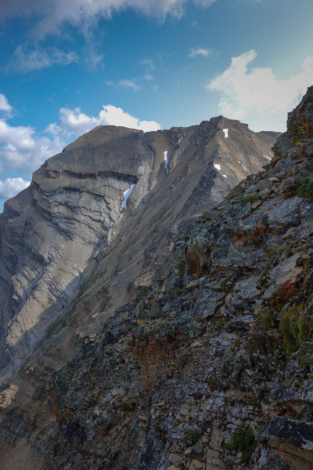 You can see the steepness and looseness of the terrain here, looking at the twin summits of Inflexible as I near the col, side-slopping on climber's left.