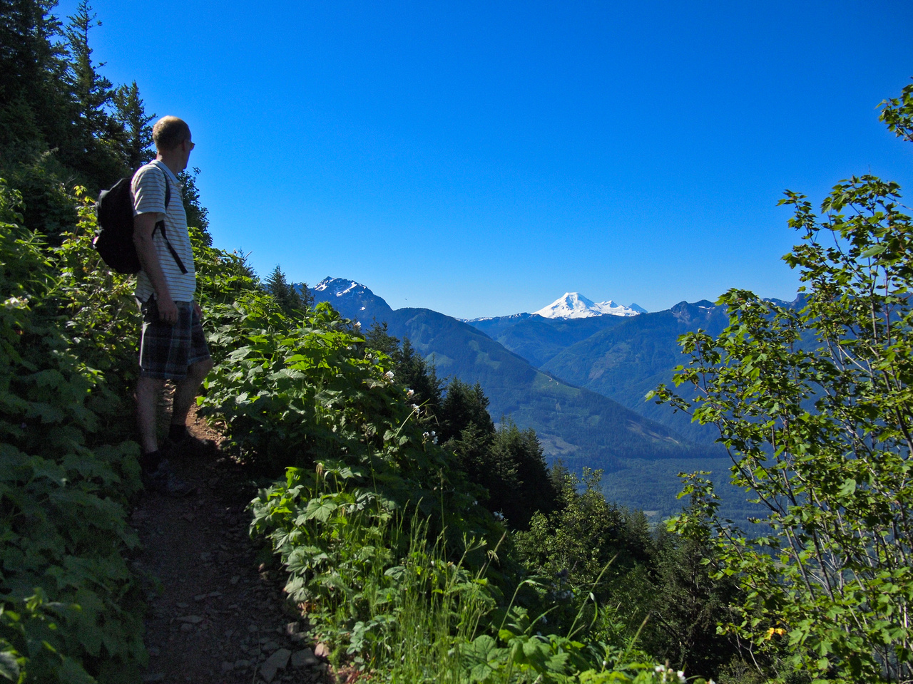 Josh looks over at the always-impressive Mount Baker from a point on the trail where the hiking becomes a bit more of a scramble.