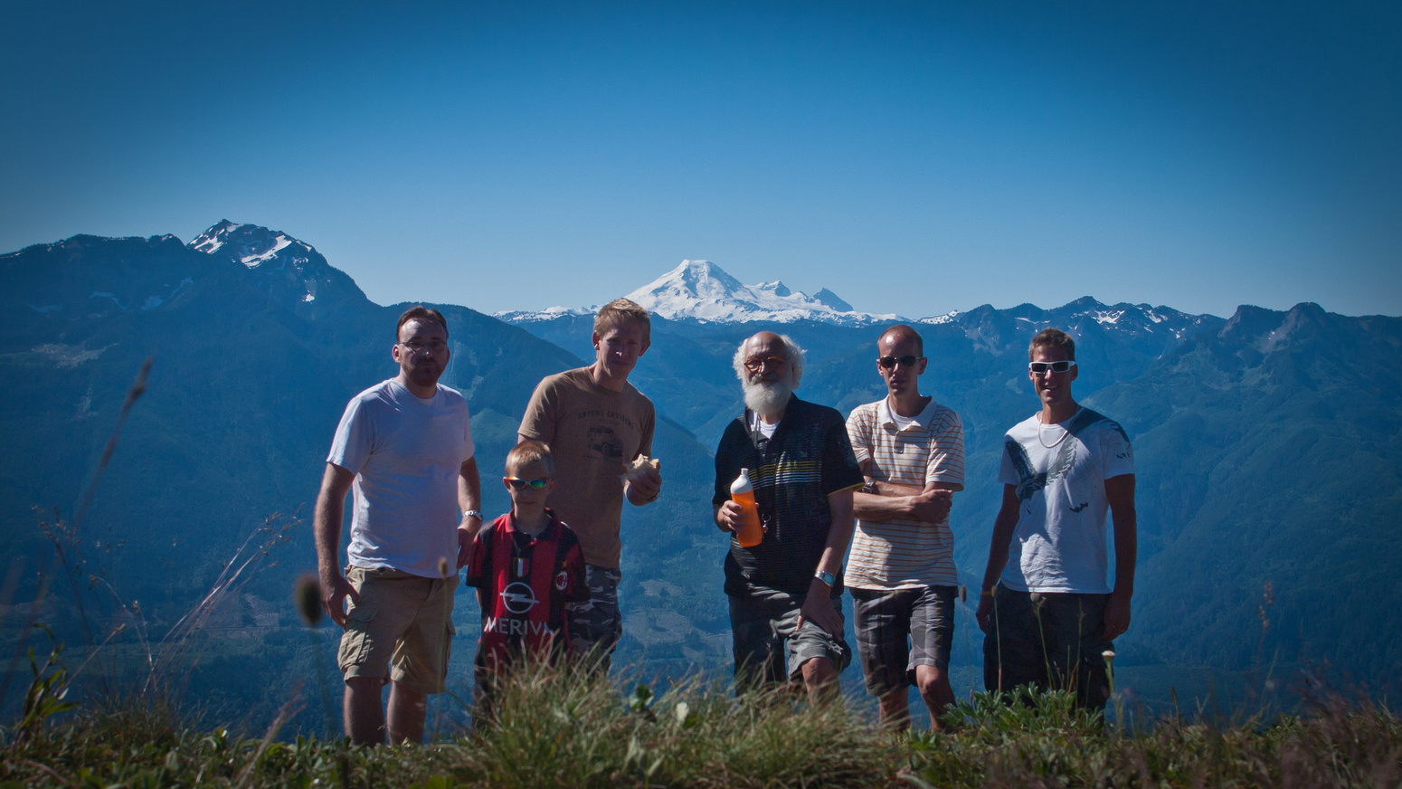 The group on the summit of Elk Mountain with Mount Baker in the background.