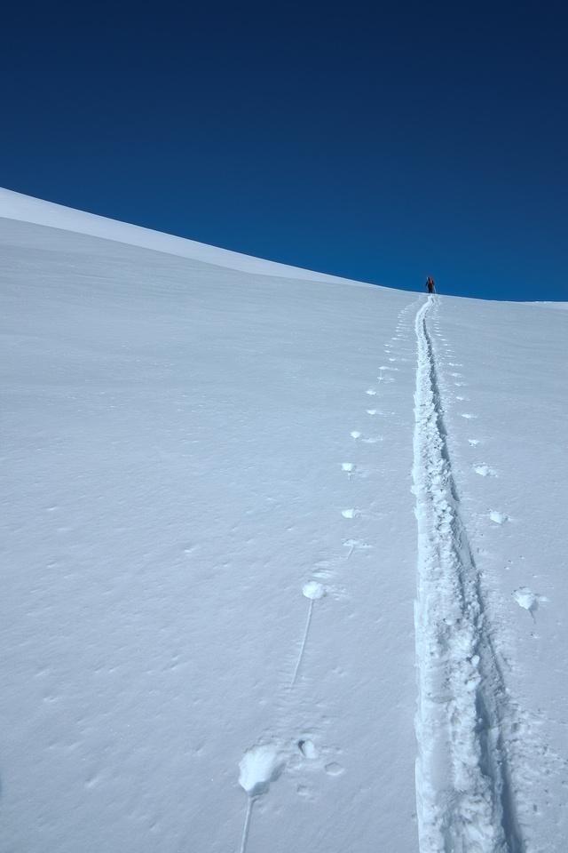 Kev breaks trail onto the ridge.