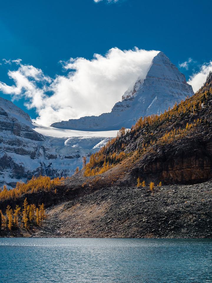 """The big """"A"""" Mount Assiniboine shows up over the shoulder of Sunburst Peak."""